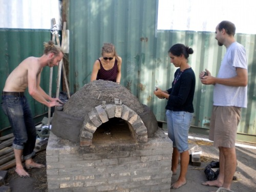 People building archie the clay oven in Helsinki